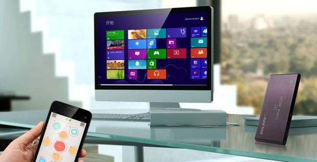 Guleek i8 (малкото устройство вдясно) може да изпълнява ролята на пълноценен компютър под управление на Windows 8.1